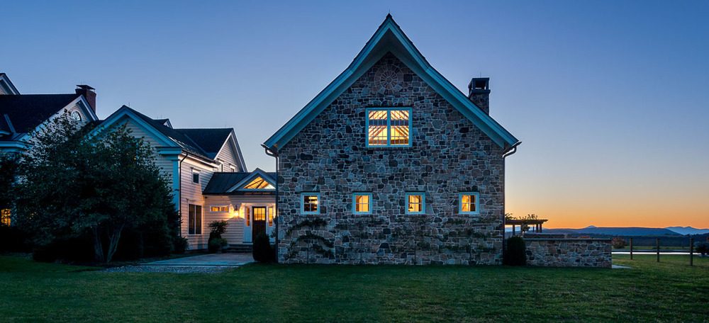 An addition like a stone barn designed by Crisp Architects