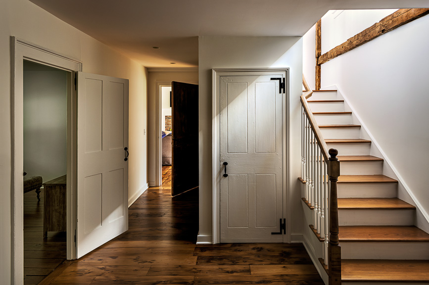 Stair hall in a Massachusetts Farm House renovated by Crisp Architects
