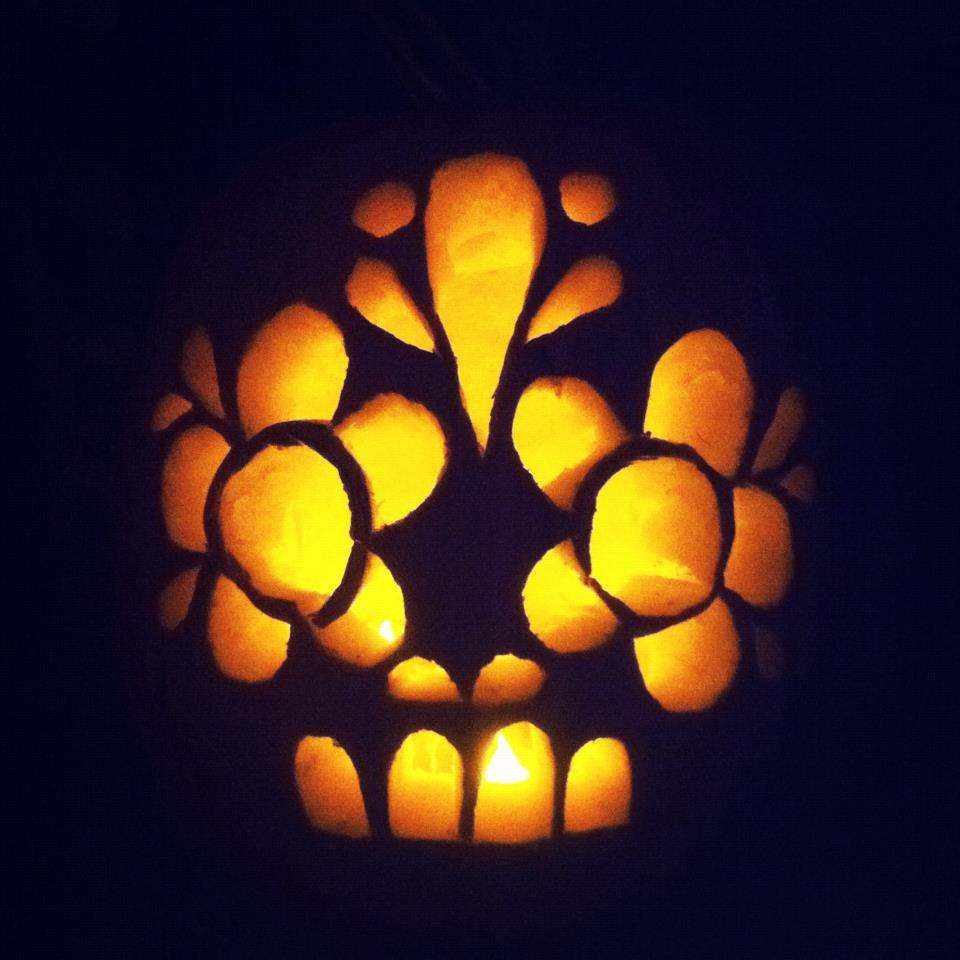 I carved a punkin tonight! I did manage to slice up my fingers before I even got the top off, but I think the blood drip down the back is festive.