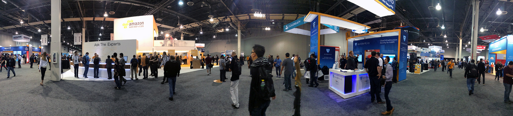 the Amazon booth (left) next to the Evident booth (right)