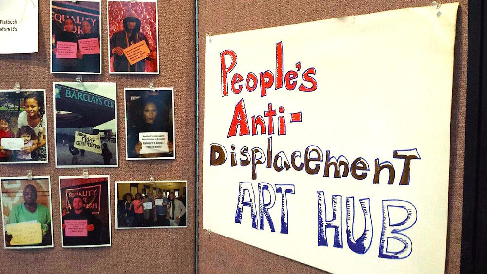 "A ""People's Anti-Displacement Art Hub"" displaying housing justice and anti-displacement themed art"