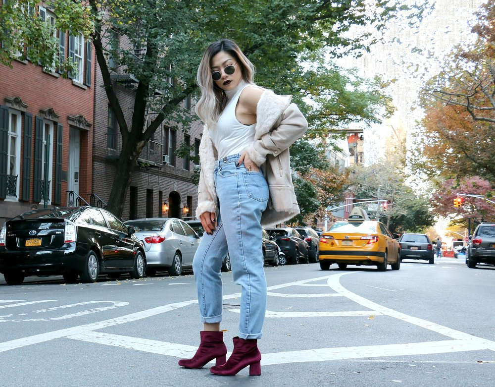 Faux Shearling Coat Boutique Mia Bonded Faux Fur Suedette Aviator  - BOOHOO  (similar coat here)  | Shoes:  Gabriella Velvet Ankle Boot from BOOHOO   (similar shoes here)  | Vintage Mom Jeans - VERSACE (thrifted -  similar jeans here  ) | White Sleeveless Turtle Neck Top: H&M ( similar top here)