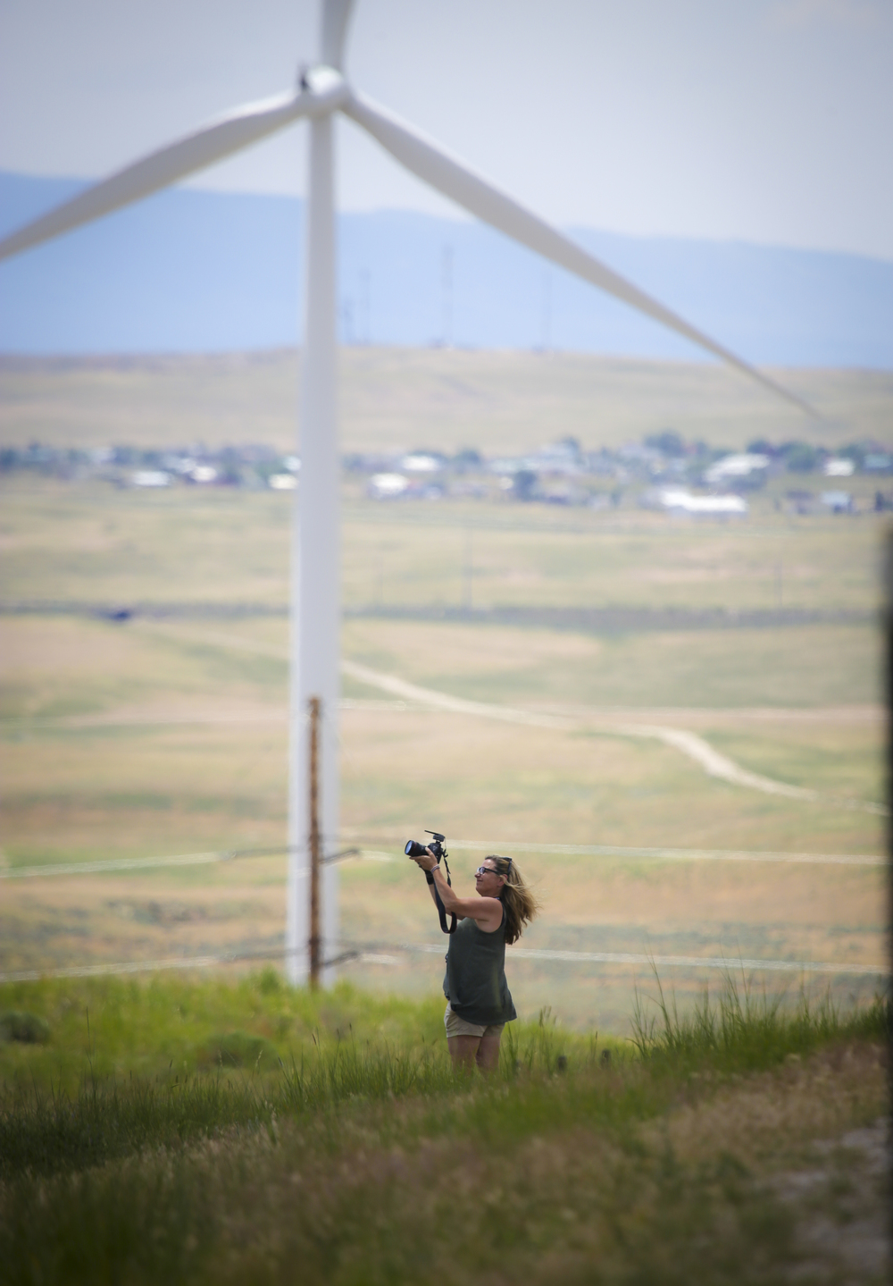 Melody Gilbert getting some footage of the wind turbines near Rolling Hills Wyoming.
