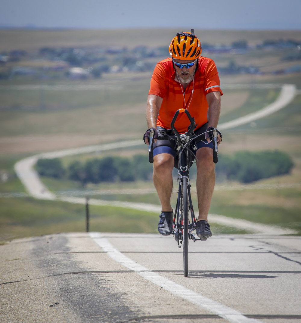"Wollemann pushes himeself and crests 'Top of the world' near Rolling Hills, Wyoming and shouts ""Now I get the pay-off"" as he zips down long downhill section in front of him."