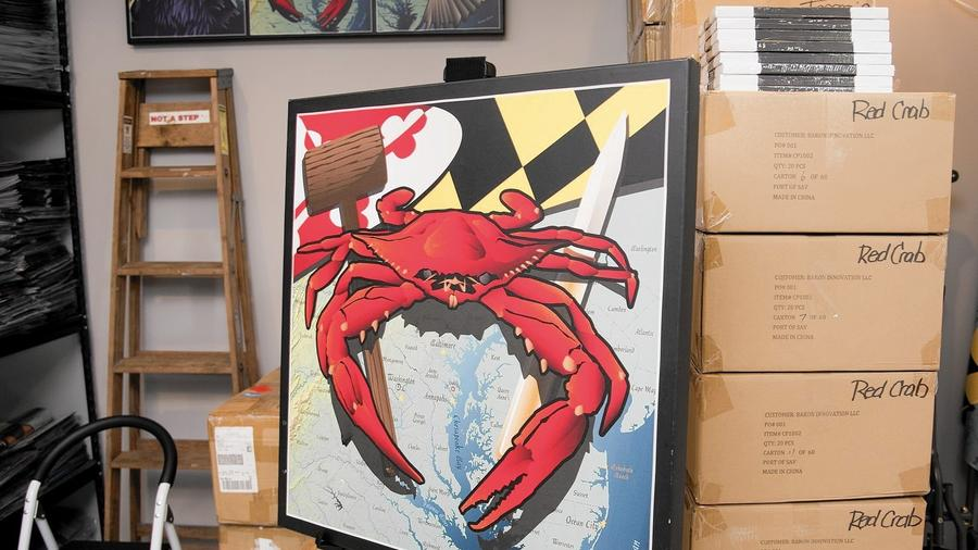 featured here, one of their large canvas COMMISSIONED works. this will hang in the family's kitchen, their name and home location marked with a star on the maryland map. --PHOTO BY JOSH MCKERROW.