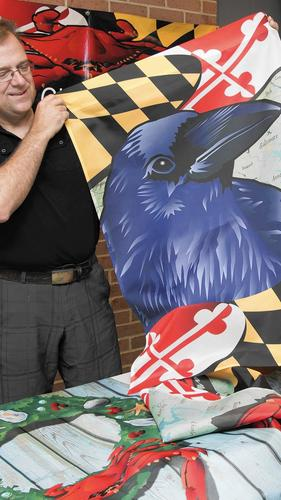 Joe barsin of citizen pride and his maryland raven house flag. --PHOTO BY JOSH MCKERROW.
