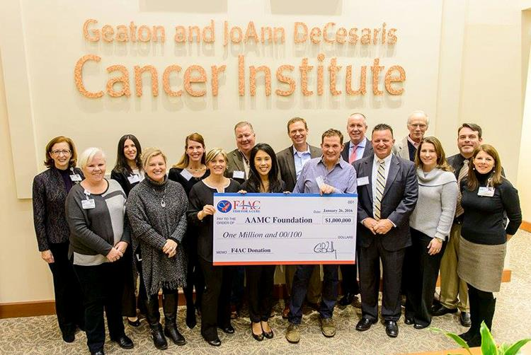 The F4AC Board shown here at the AAMC check presentation ceremony
