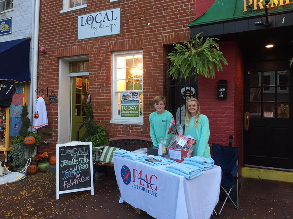 Members of the f4ac Junior board SELLING shirts at our Citizen pride & lOCAL by Design sponsored fundraiser event in late October. every little bit helps throughout the year for f4AC!