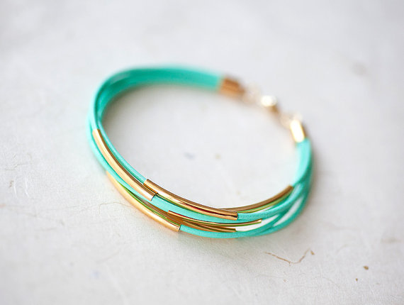 The stylish mint green leather bracelet with six golden tubes by Etsy seller, Pardes, in Israel, is a delicate but colorful way to add to any outfit!
