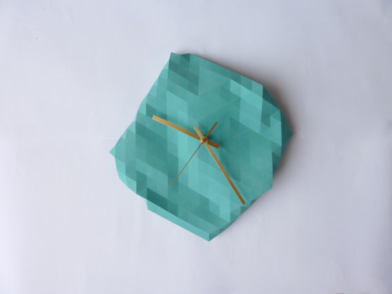 Just the Right Timing Love the faceted turquoise wall clock by Etsy Seller, RawDezign, in Birmingham, England. Each clock is hand built in their studio through individually casting turquoise resin. Then, it is formed in a flexible mould that is manipulated by hand for each piece. RawDezign also has other creative home decor pieces with a faceted and geometric flair at their shop!