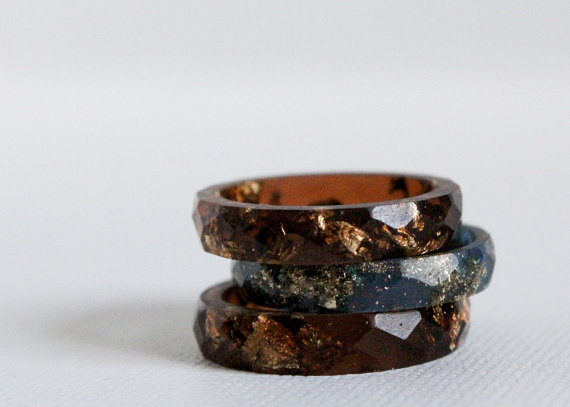 Adore this trio of rings in amber brown and midnight blue, each featuring gold flakes, by Etsy Seller, RosellaResin, in Ottawa, Ontario.  These rich, deep colors are perfect for this time of year, with the gold being a perfect offset. I also love that RosellaResins' jewelry is eco-friendly—it's  made of eco-resin, a material that has been certified by the USDA as a bio-based product. Each ring above is sold separately and can be worn stacked or solo, although I'm partial to having them stacked. Check out RosellaResin's shop for its entire collection of eco-resin jewelry.