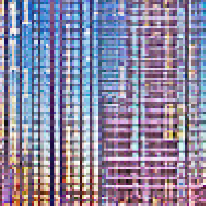 Low-resolution (pixellated) image of a high-rise building, at sunset.