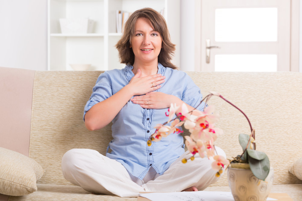 Woman practicing energy medicine