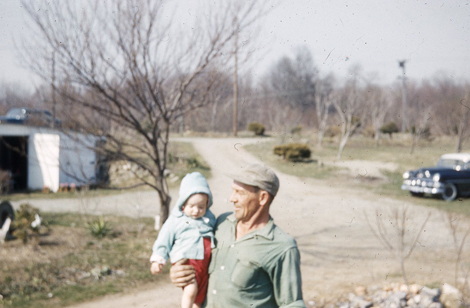 Ralph Perry with his granddaughter Irene in River Crest Farm's early days.