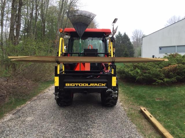 Bigtoolrack on a Kubota 3560 using the Lumber Hooks to install a Split Rail Fence