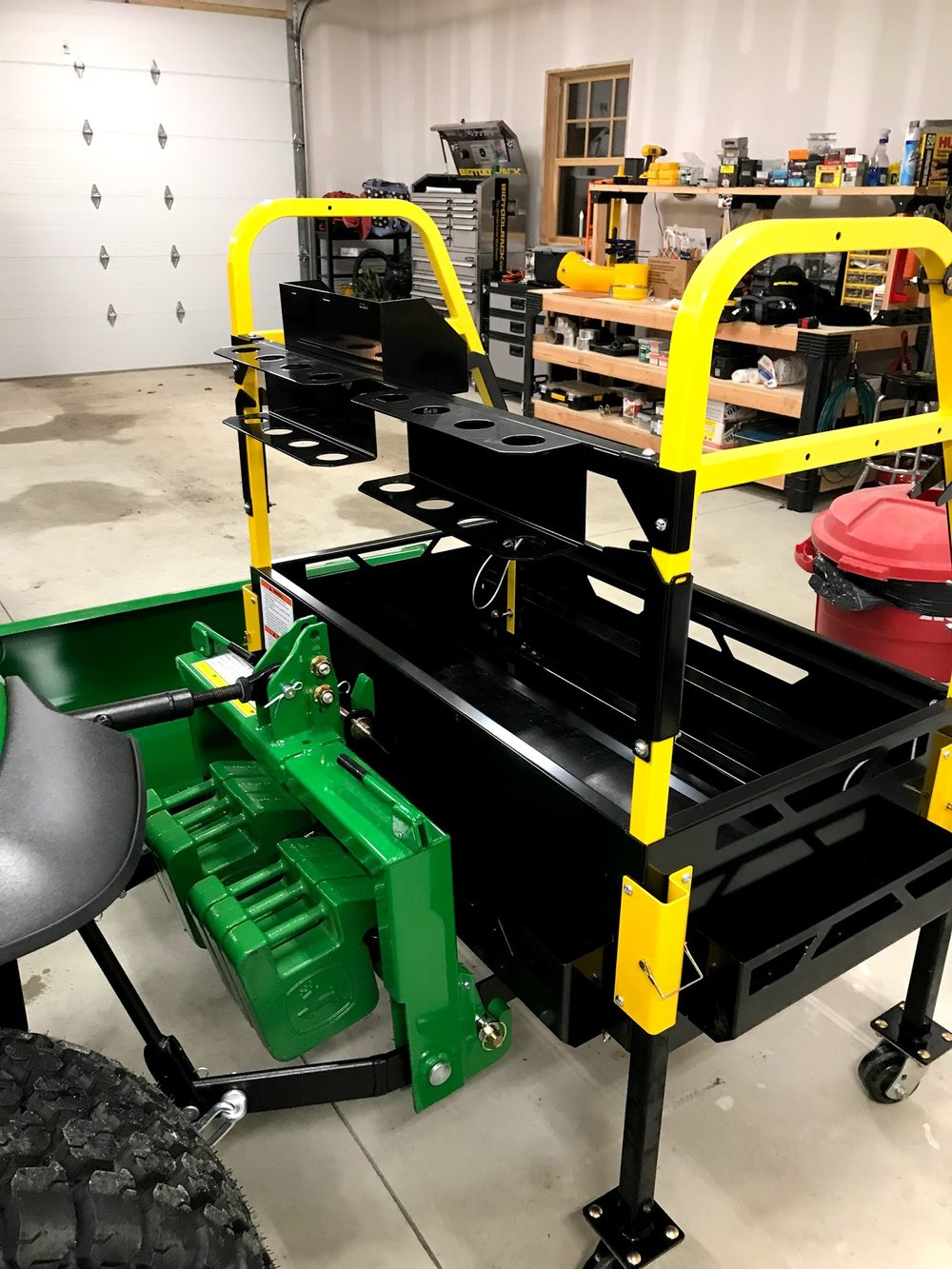 Bigtoolrack on a John Deere 2038R Imatch and 6 42 LB suitcase weights
