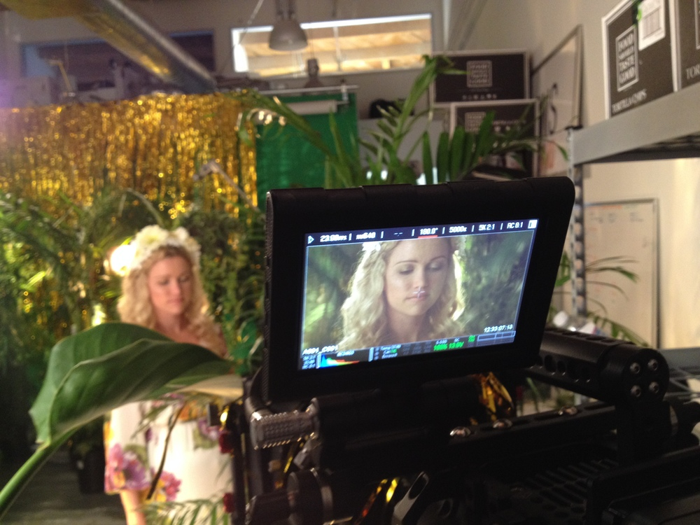 How do you make a typical jungle more interesting? Layers of depth. Weird lenses. Pretty girl. SHIMMER THINGS.