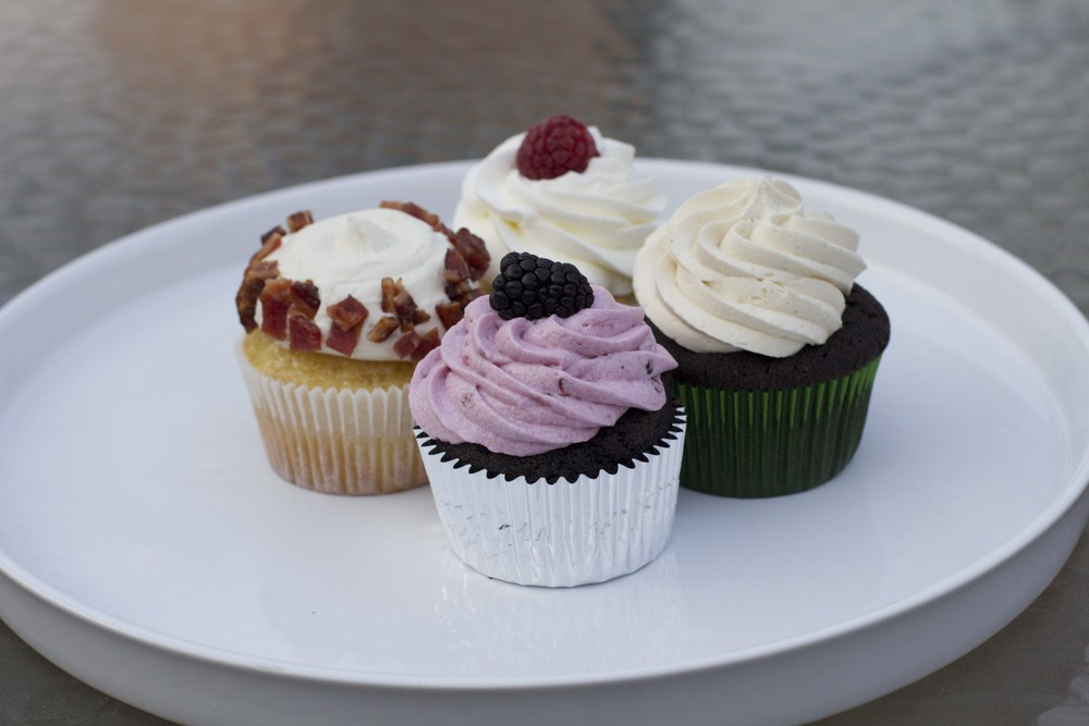 Chocolate cupcake with fresh blackberry buttercream and topped with a fresh blackberry, Salted Caramel cupcake, and Fresh Raspberry cupcake