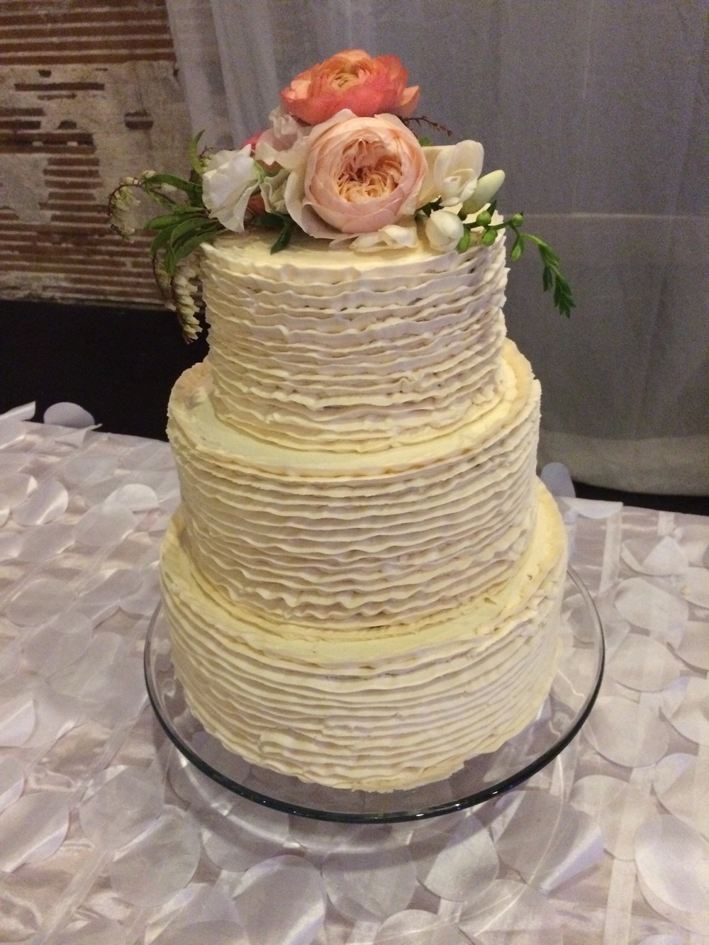Vanilla bean wedding cake with buttercream ruffles