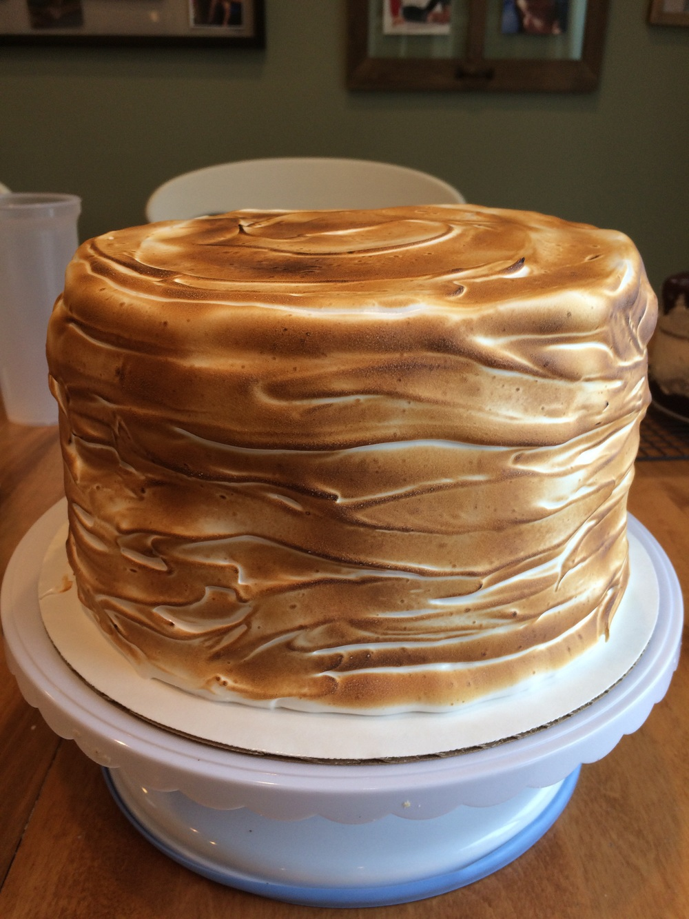S'mores cake, chocolate cake filled with graham cracker buttercream and topped with toasts homemade marshmallow frosting