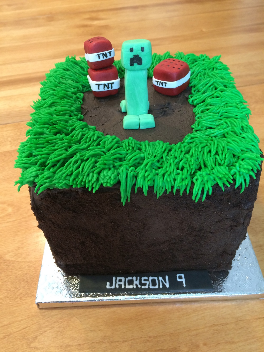 Minecraft birthday cake, chocolate cake covered in black cocoa buttercream and Oreo crumbs with Minecraft accents