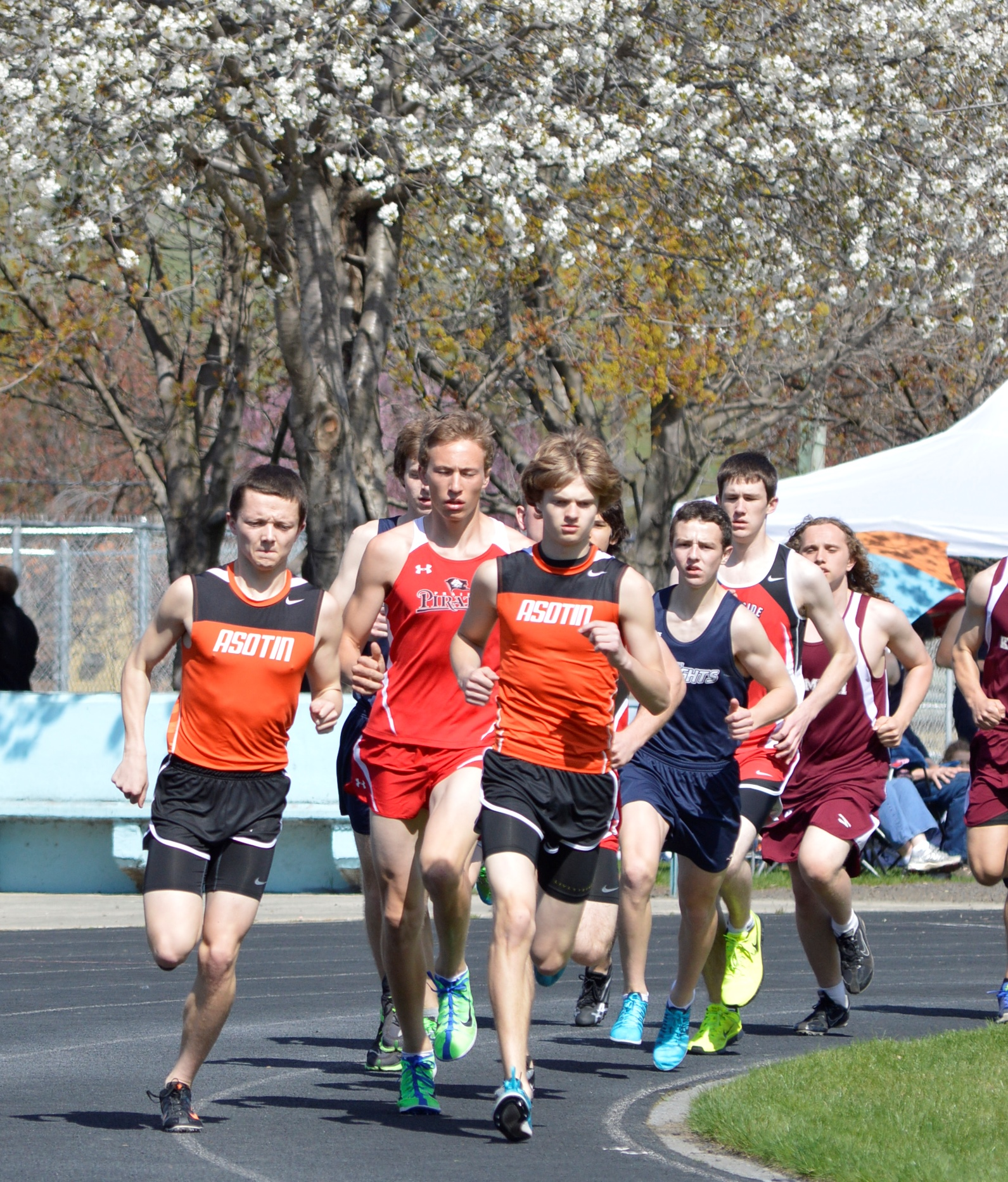 Thomas Weakland, Peter Spence, and Brady McKay lead the field out in the 3200M at the Border Wars Meet in Lapwai, Idaho.