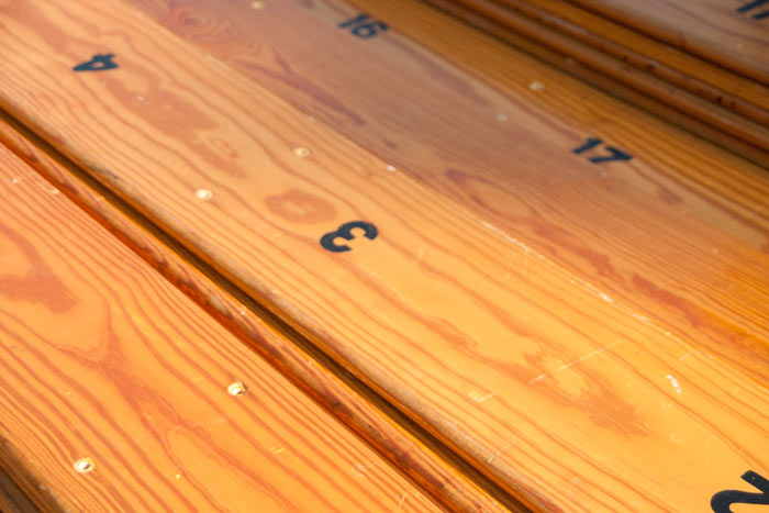 reclaimed-bleacher-wood-with-numbers.jpg