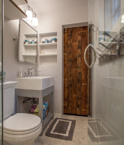 reclaimed-wood-door-in-white-marble-bathroom.jpg