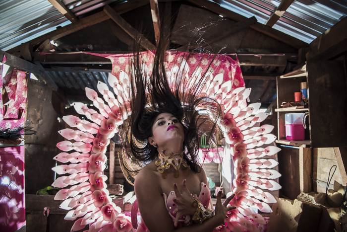 Sazzy (21) - Sazzy is a make up artist, costume maker and pageant beauty in the community of Anibong in Tacloban City. She lives in her one room house with her partner Ronald since they were 17 years old. Ronald built the house for her.