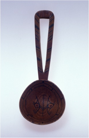 Yup'ik spoon showing a painted design on the interior of the bowl. University of Alaska Museum of the North UA98-016-0001