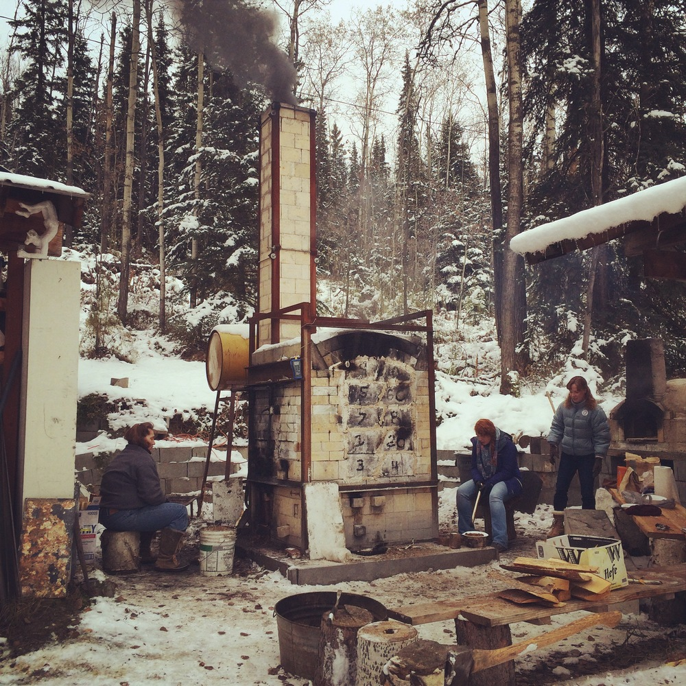 A few of the most outstanding UAF students helping to fire the kiln.