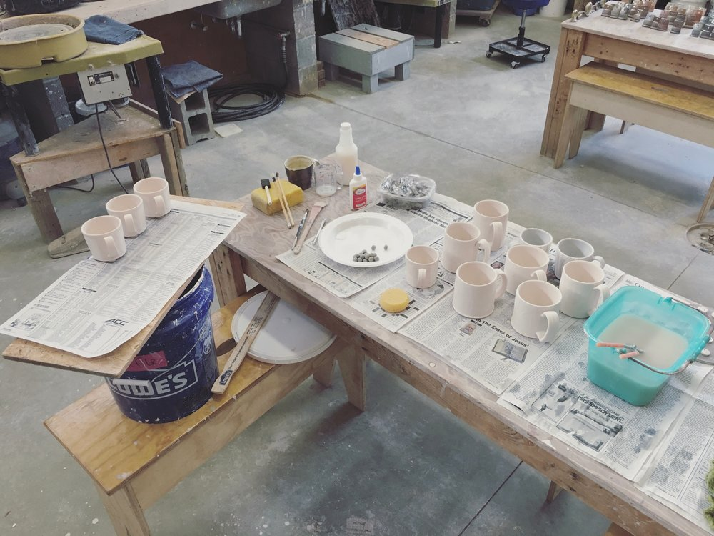 The glaze station.  All the work is glazed according to the chamber it is being fired in. Each chamber has a unique effect on the glazes and I can take advantage of that in the glazing phase of the process.