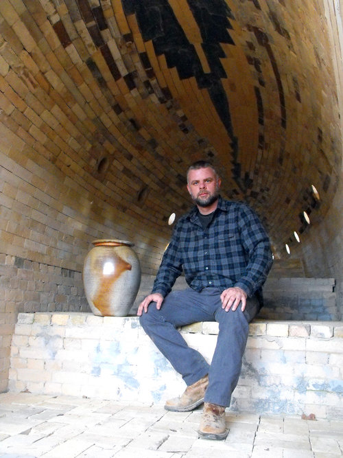 Meet Chad Brown! He's a 5th generation, Seagrove Potter.  Chad is seated in his newly constructed 30' long wood kiln.  Like I said, he needs a post of his own, but for now, you can learn more about Chad, his pots, and wood kiln on his website,  here !