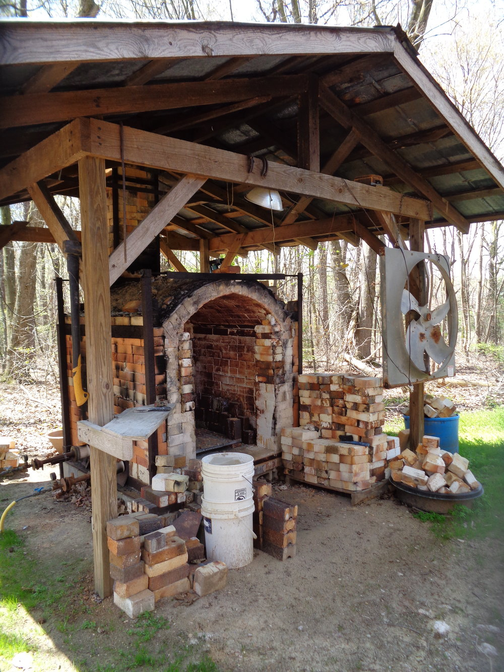 And this is the gas/salt kiln that we fired last week--she's a soft brick downdraft kiln Chad built early on his career. Chad's estimated that he's fired this kiln about 100+ times.