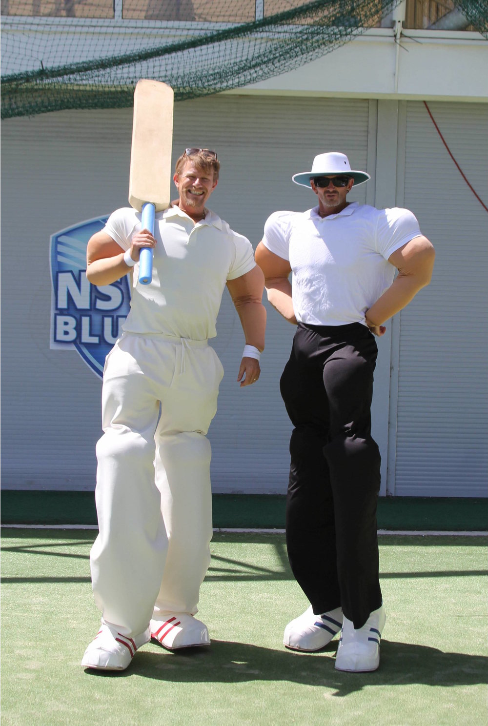 Cricketer and Umpire on Stilts copy.jpg