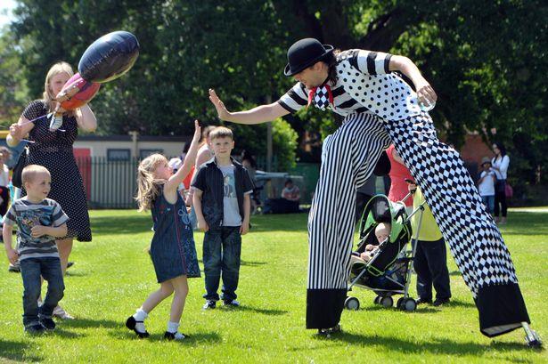Circus stilt walker high 5.jpg