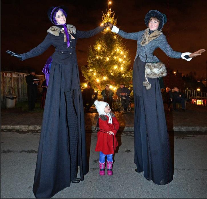 Victorian christmas stilt walkers.jpg
