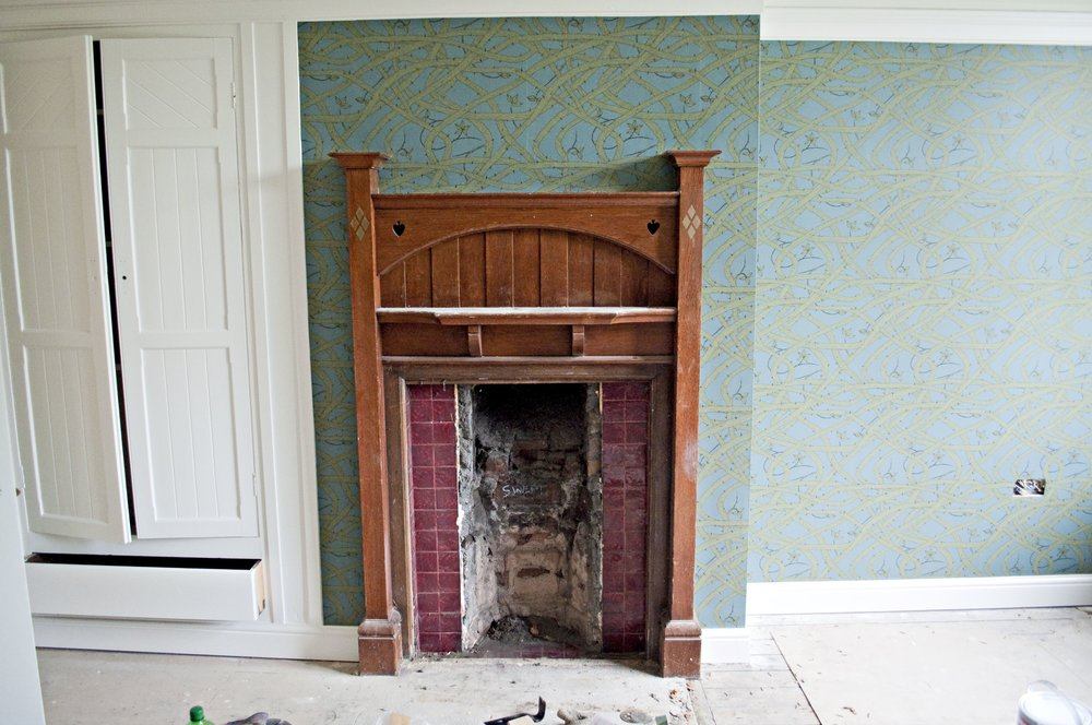 We've got a bedroom decorated...and we've uncovered the original fireplace tiles