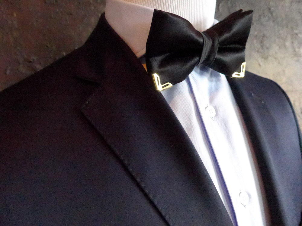 Custom made bow tie with corner adornments.