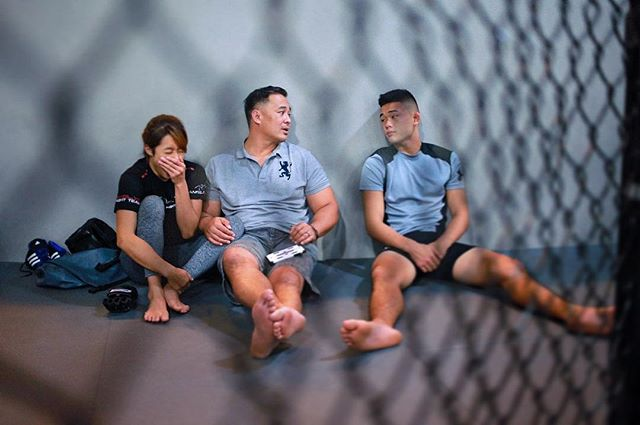 """#onefc fighter #angelalee lets out a big yawn after a packed morning of media obligations on Thursday. She is pictured here with her dad Ken and brother Christian after a video shoot.  The 19-year-old had just flown in from Hawaii on a 17-hour flight a day earlier. Still showing signs of jet-lag, """"Unstoppable"""" was under the weather during today's shoot.  Despite a hectic media schedule right around the corner of fight week, Angela was very accommodating and easy to work with. I wish her all the best in her bid to become to youngest ever #mixedmartialarts world champion on May 6.  #mma #fightlife #fightsport #onassignment #igsg #sgig #singapore #instasg #instadaily #sgvsco #vsco #vscocam"""