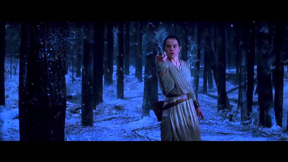 Rey catches the lightsaber