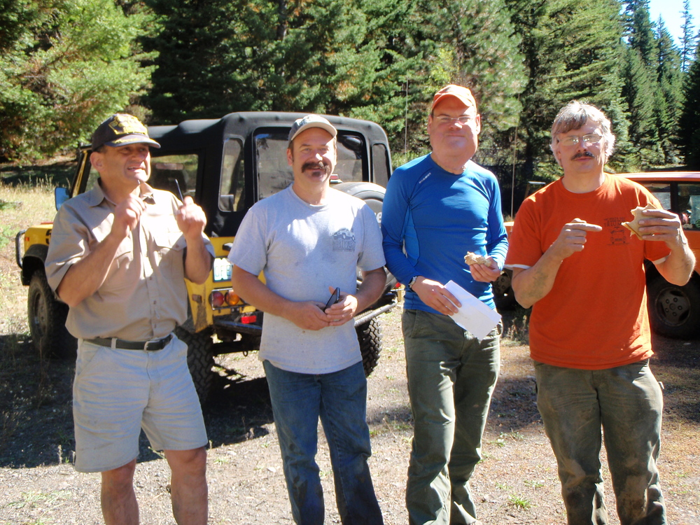 A rare moment at rest:  Lar, Cary, Nick, and Gord'n take a quick break during transition between tasks at the 2014 Northwest Challenge.
