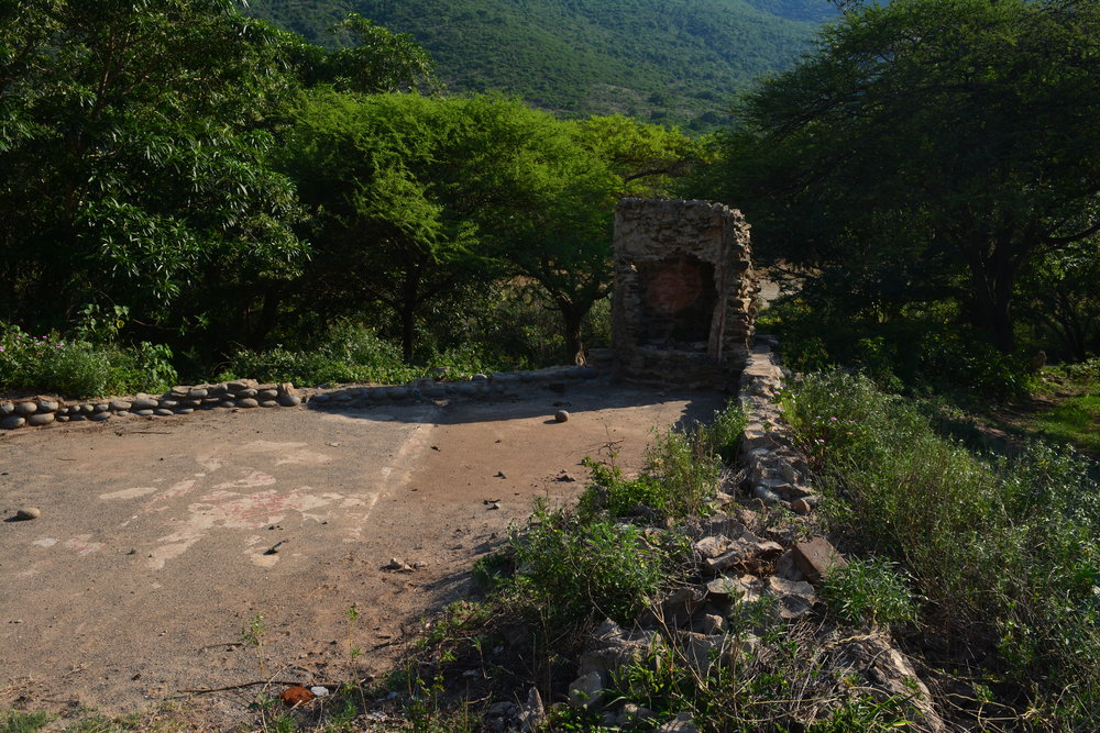 The remains of the boma foundation and the bar crumble as nature reclaims them.