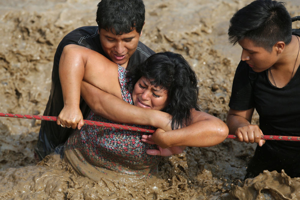 """The death toll in Peru's flooding and mudslides reached 90 over the weekend, according to state-run news agency Andina.More than half a million people in and around the country's capital, Lima, have been affected by storms and flooding, authorities said. """"We know it is a difficult situation, but we are controlling it, and we are hopeful that it will soon pass,"""" President Pedro Pablo Kuczynski said."""