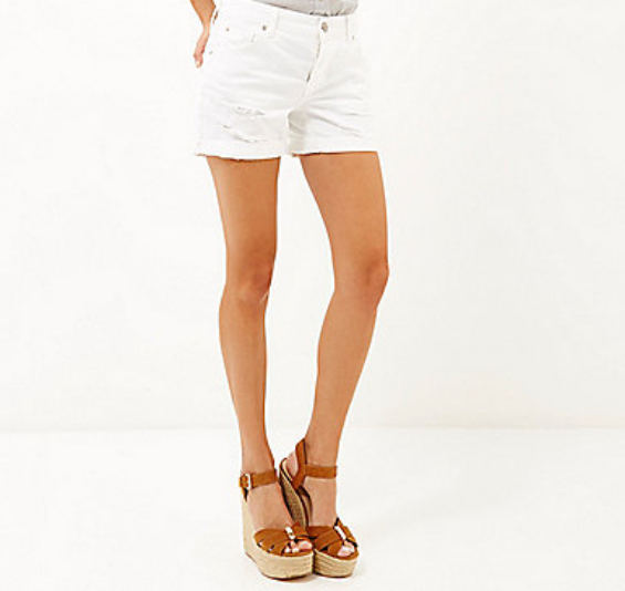 River Island: White ripped ultimate boyfriend shorts $64