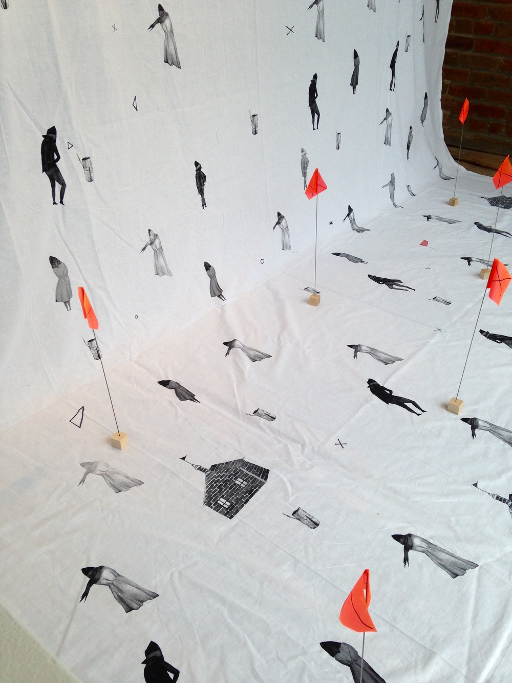 Window installation, 10 ft X 15 ft silkscreen printed fabric and orange safety flags