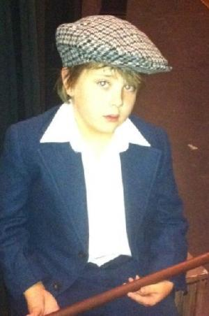 "Broomfield resident Murray Rundus, 9, is playing Tiny Tim in the Candlelight Dinner Theater production of ""Scrooge."" Photo submitted by Jena Rundus Broomfield Enterprise."