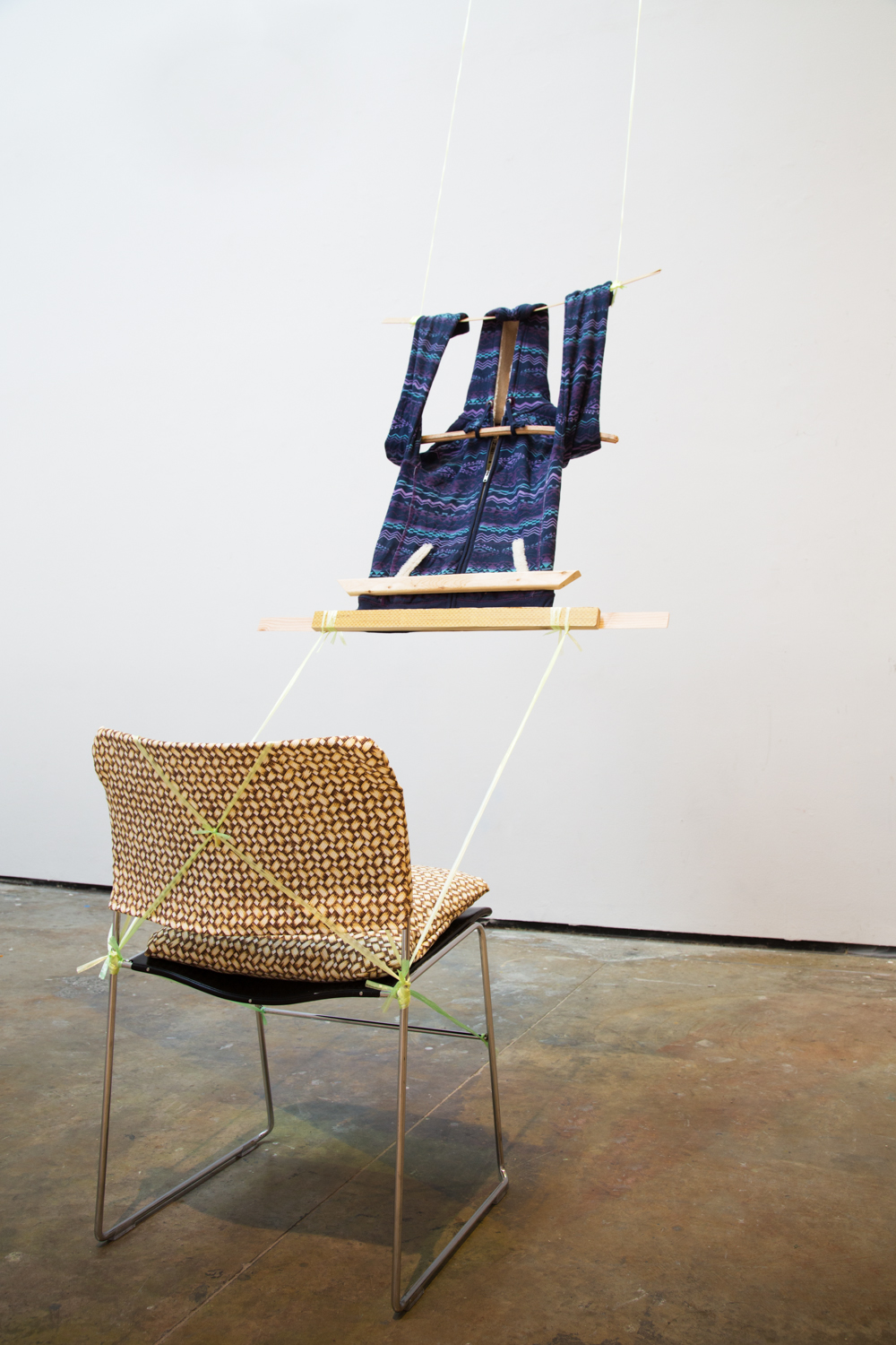 Loom, 2014, hoodie, plastic chord, wood, custom Banig-print fabric chair covering, Yale critique chair, 240 x 20 x 20 inches