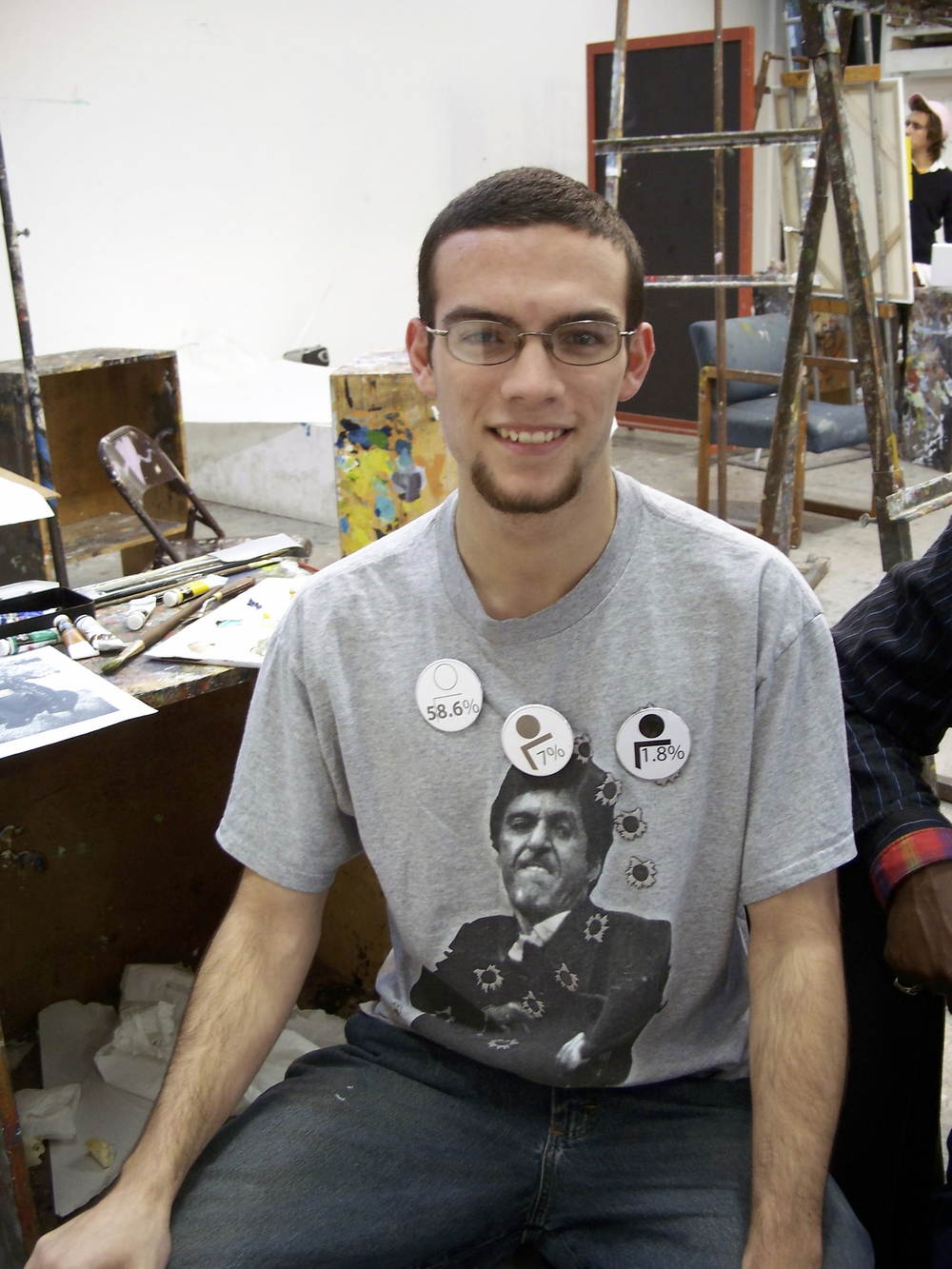 Undergraduate painting student wearing multiple buttons