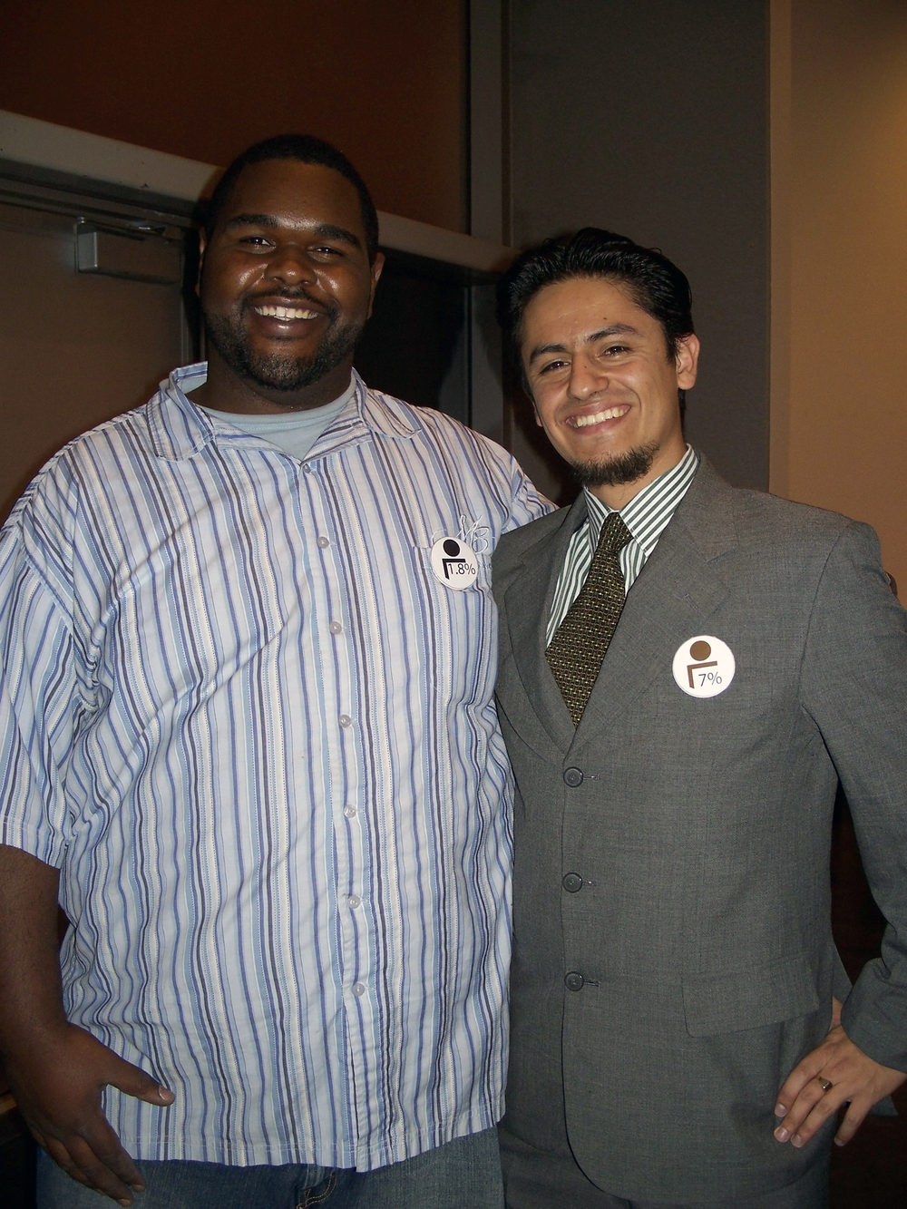Students, Robert Yancey and Carlos Sevadra, sporting their buttons at CCA art opening